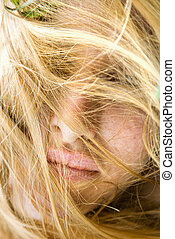 Face covered in hair. - Close up portrait of redheaded woman...