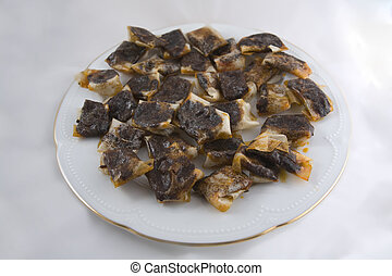 Jelly black pudding on plate - Jelly black pudding isolated...
