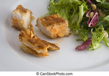 Dogfish marinated with salad isolated over white background
