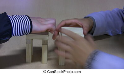 Kids building tower from toy blocks - Two boys together...