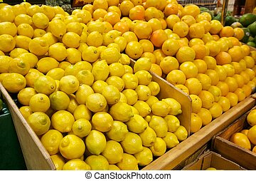 Wooden Bins Filled with Fresh Lemons and Oranges