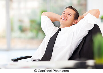 businessman daydreaming - handsome businessman daydreaming...
