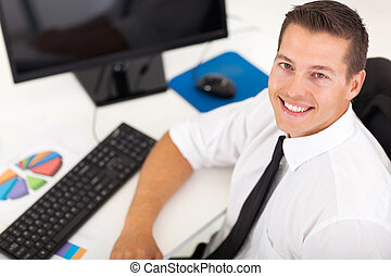 overhead view of young businessman sitting in office