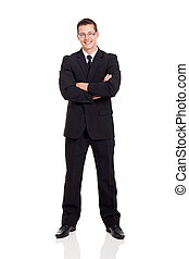 businessman in a suit with arms crossed