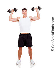young man lifting dumbbells - happy young man lifting...