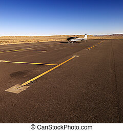Small plane on tarmac at airport.
