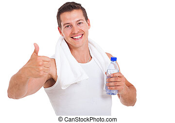 fitness man holding water bottle and giving thumb up -...