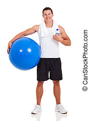 healthy man holding a gym ball isolated on white