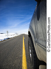 Car on road in winter. - Perspective shot of SUV driving...