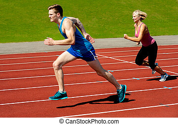 Athletes running on race track - Sprinters racing on the...