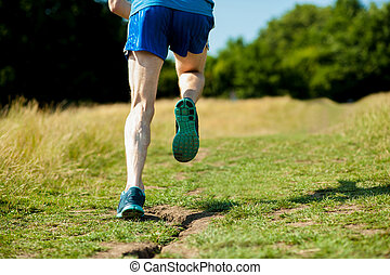 Young fit man running outdoors