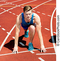 A male athlete ready to run the race - Young sportsman on...