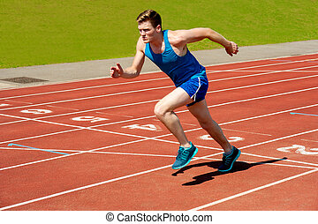 Male runner on starting blocks