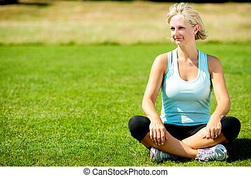 Woman relaxing outdoors, peaceful morning. - Middle aged...