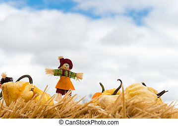 Halloween scarecrow - Halloween doll with pumpkins against...