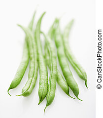 String beans. - Selective focus shot of green beans on white...