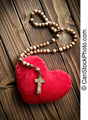furry heart with rosary beads - top view of furry heart with...