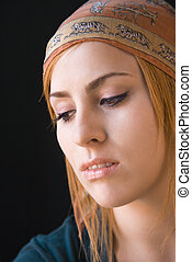 Woman thinking - Young redheaded woman wearing cap looking...