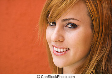 Smiling young woman - Young redheaded woman smiling at...