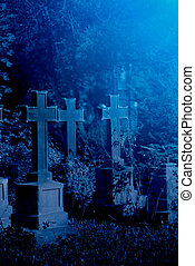 Old misty graveyard at night - Mystery old graveyard with a...