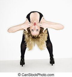 Woman bending over backwards. - Portrait of young caucasian...