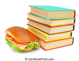 Sandwich with bacon and multi-coloured books on a white background.