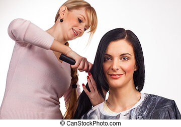 Hairdresser working with a client - white background