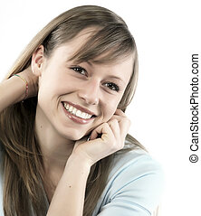 Closeup portrait of a happy young woman smiling isolated on...