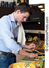 Young man preparing lunch
