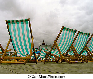 Deckchairs on a pier