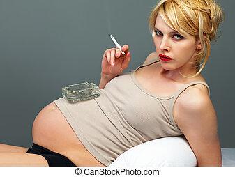 Pretty pregnant with a cigarette and ashtray