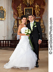 Young couple just married inside of church - Wedding - young...