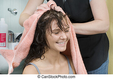 shaking my head - brunette in salon hair getting her hair...