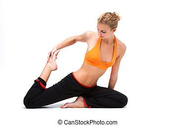 Younge woman stretching the muscles of her legs - white...