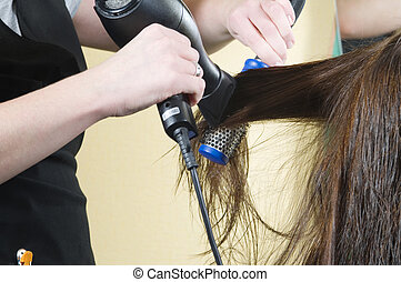 brush and dry - close up of girl head in beauty salon while...