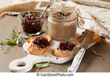 Chicken liver pate with onion jam on bread and in jar