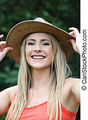 Happy young woman in a wide brimmed hat - Happy young woman...