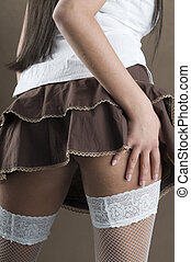 stocking - close up of legs with white stocking and brown...