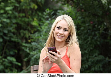 Beautiful woman text messaging on her mobile