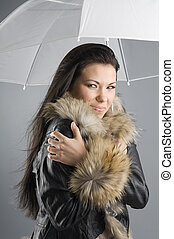 bad weather - pretty brunette with fur jacket and white...