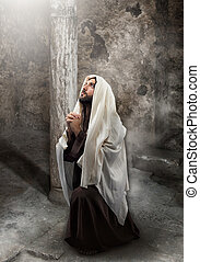 Jesus kneel in prayer toward the light