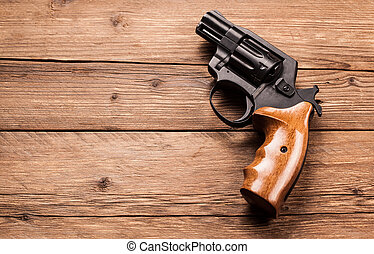 pistol on a wood background