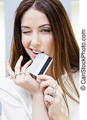 Lady with lots of rings on hands keeps credit card Concept...