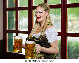 Serving beer during Oktoberfest - Photo of a beautiful...