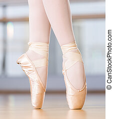 Close-up view of dancing legs of ballerina in pointes -...