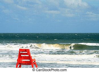 Lifeguard chair against a choppy sea