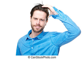 Confused male individual with hand in hair - Portrait of a...