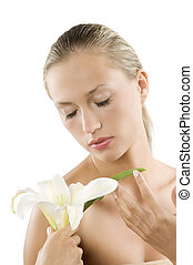 closed eyes - young blond woman smelling with her eyes...