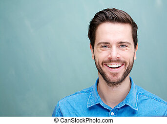 Portrait of a handsome young man with beard smiling -...