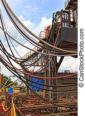 Chaos of hoses, pipelines and cables - Many hoses of...